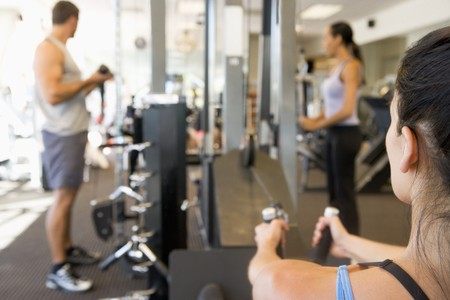 Group Of People Weight Training At Gym photo