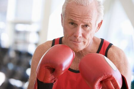 healthy seniors: Man Boxing At Gym