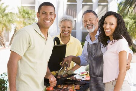 Family Enjoying A Barbeque Stock Photo - 4499333