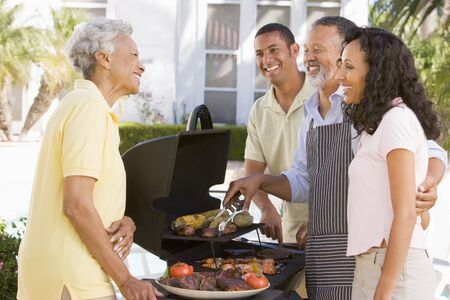 Family Enjoying A Barbeque Stock Photo - 4499289