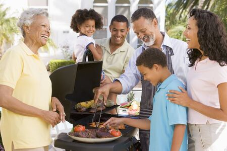 Family Enjoying A Barbeque Stock Photo - 4499185