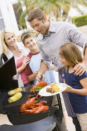 9 year old: Family Enjoying A Barbeque Stock Photo