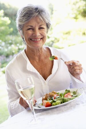 Senior Woman Eating An Al Fresco Lunch photo