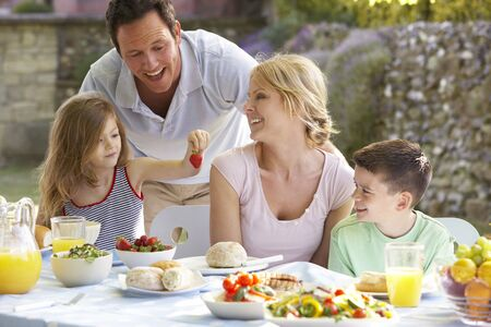 Family Eating An Al Fresco Meal photo