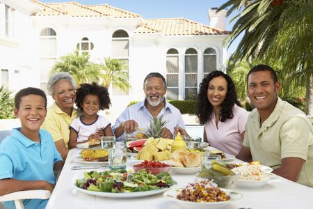 outdoor eating: Family Eating An Al Fresco Meal