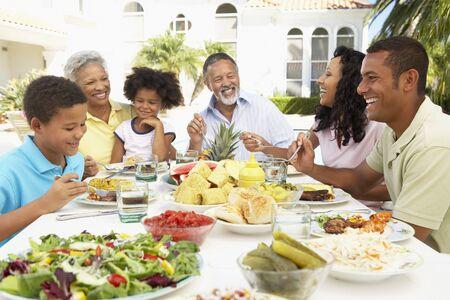 Family Eating An Al Fresco Meal photo