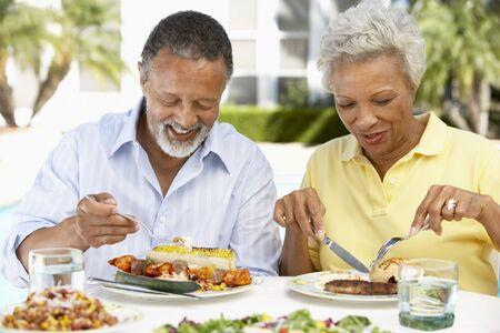 Couple Eating An Al Fresco Meal photo