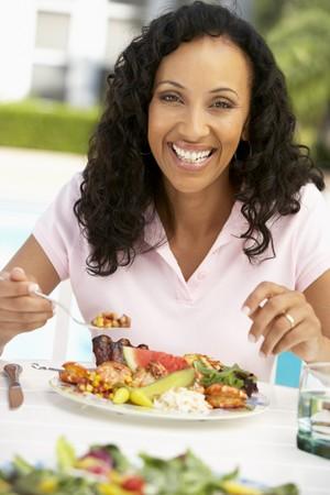 al: Middle Aged Woman Dining Al Fresco