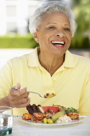 Senior Woman Dining Al Fresco Stock Photo - 4499039