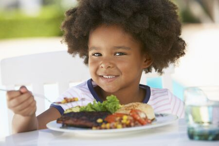 age 5: Young Girl Dining Al Fresco