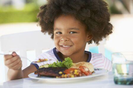 Young Girl Dining Al Fresco photo