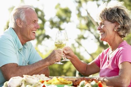older women: Couple Eating An Al Fresco Meal