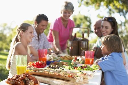 family dining: Family Dining Al Fresco Stock Photo