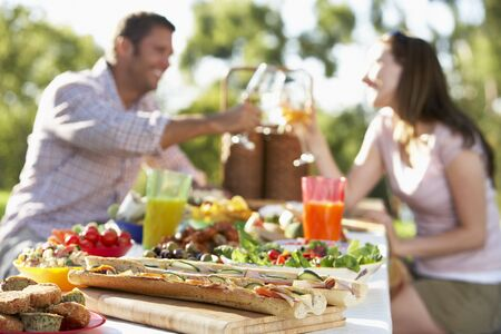 Couple Dining Al Fresco, Toasting Each Other photo