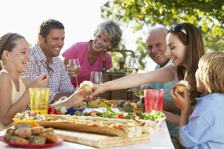 outdoor eating: Family Dining Al Fresco Stock Photo
