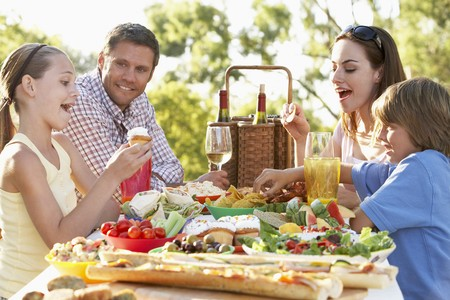 woman eat: Family Dining Al Fresco Stock Photo