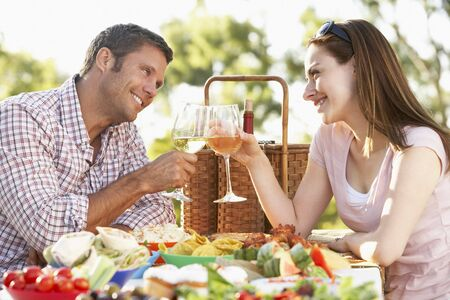 Couple Eating An Al Fresco Meal, Toasting With Wineglasses Stock Photo - 4499827