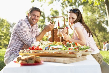 filled roll: Couple Eating An Al Fresco Meal