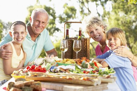 11 year old: Family Dining Al Fresco Stock Photo