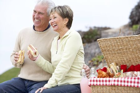 Couple Eating An Al Fresco Meal At The Beach photo