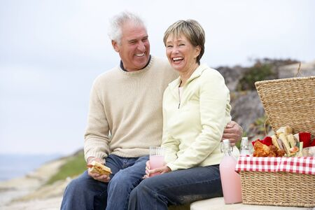 al: Couple Eating An Al Fresco Meal At The Beach Stock Photo