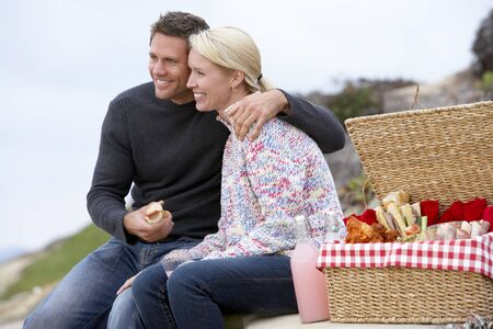 Couple Eating An Al Fresco Meal At The Beach photo