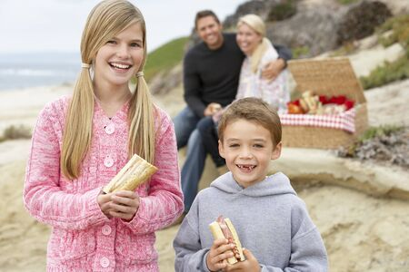 filled roll: Family Dining Al Fresco At The Beach