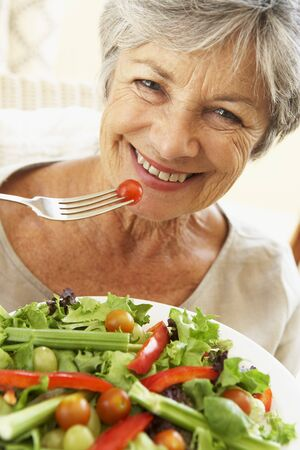 Senior Woman Eating Healthy Salad Stock Photo - 4499497
