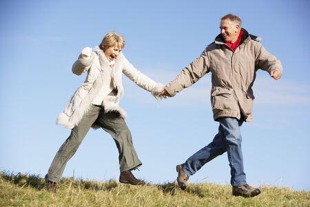 Senior Couple Running In The Park photo