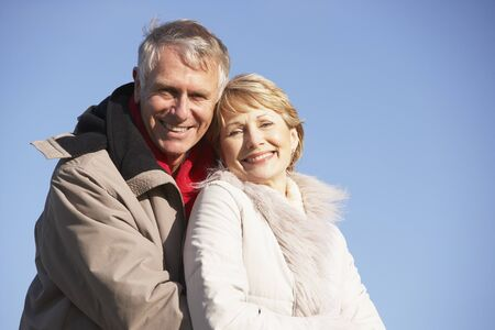 Senior Couple Embracing In Park Stock Photo - 4506467