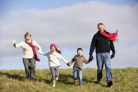 Grandparents And Grandchildren Running In The Park Stock Photo - 4506582