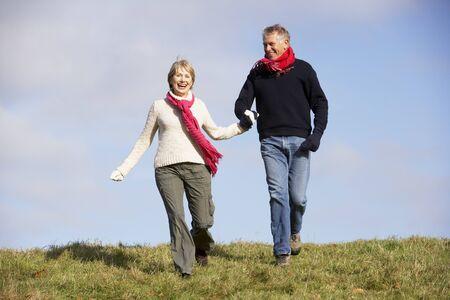 Senior Couple Running In The Park Stock Photo - 4506579