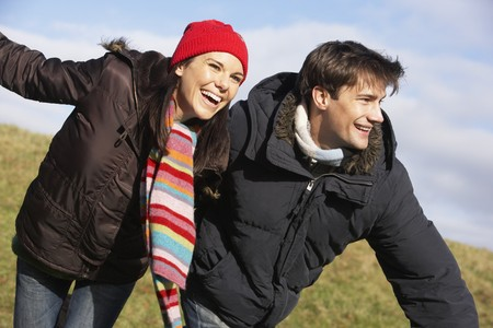 Couple Laughing In The Park Together photo
