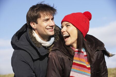 couple laughing: Couple Laughing In The Park Together