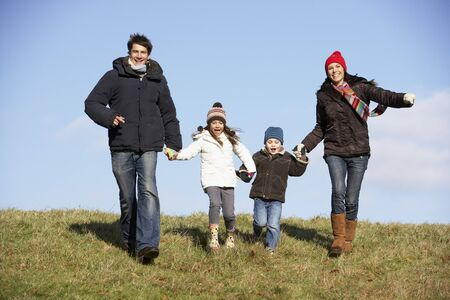 Family Running In The Park photo