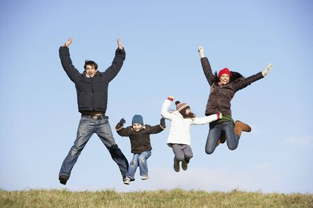 winter day: Family Jumping In The Air