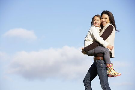 carrying girl: Mother Carrying Her Daughter Stock Photo