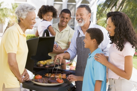 Family Enjoying A Barbeque Stock Photo - 4513869
