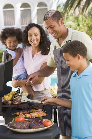 age 5: Family Enjoying A Barbeque Stock Photo