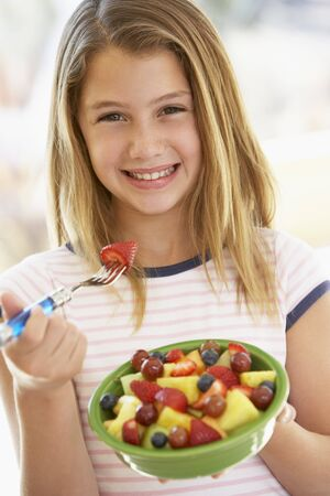 preteen girls: Young Girl Eating Fresh Fruit Salad