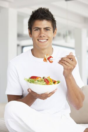 19 year old: Young Man Eating A Salad Stock Photo