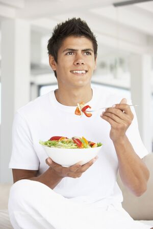 Young Man Eating A Salad photo
