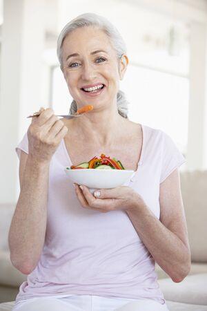Senior Woman Eating Salad photo