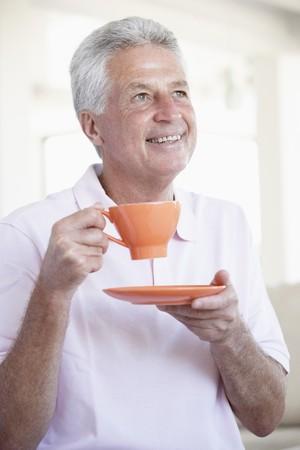 Middle Aged Man Holding Orange Mug photo