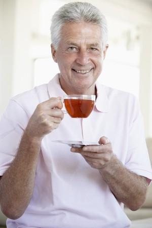 Middle Aged Man Drinking Tea photo