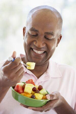 salade de fruits: Middle Aged Man Eating Fresh Fruit Salad