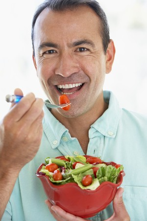 healthy person: Middle Aged Man Eating A Fresh Green Salad Stock Photo