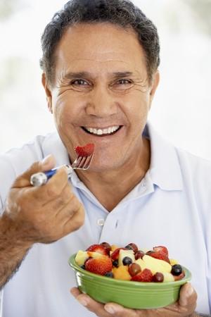 Senior Man Eating Fresh Fruit Salad