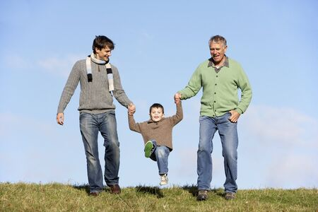 Father And Grandfather Swinging Young Boy photo