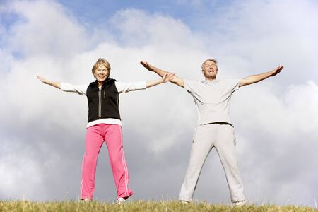 Senior Couple Exercising In The Park photo